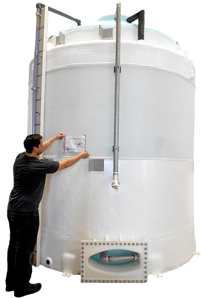 Safety Signage Being Placed on Large Tank